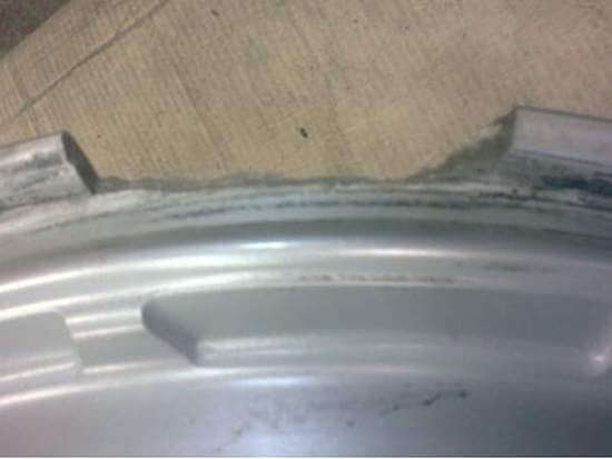 Alloy wheel before repair